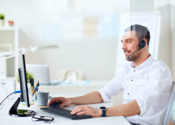 businessman with headset and computer at office